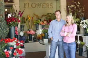 Couple standing outside florist